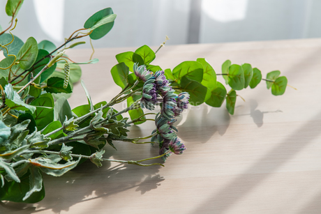 Artificial flower on table.   Modern lifestyle concept.の写真素材 [FYI04085282]