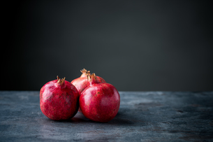 Ripe pomegranate. Pomegranate on black background. Dessert,food.の写真素材 [FYI04090644]