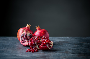 Ripe pomegranate. Pomegranate on black background. Dessert,food.の写真素材 [FYI04090646]