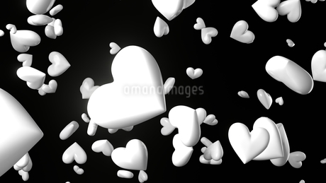 White heart objects in black background. Cute heart-shape abstract 3d illustration.のイラスト素材 [FYI04118147]