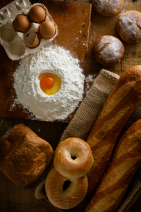 Fresh bread image. Breads,baguettes,bagels and flour with some eggs.の写真素材 [FYI04295179]