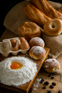 Fresh bread image. Breads,baguettes,bagels and flour with some eggs.の写真素材 [FYI04295183]