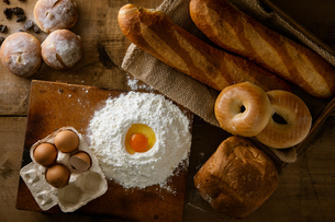 Fresh bread image. Breads,baguettes,bagels and flour with some eggs.の写真素材 [FYI04295364]