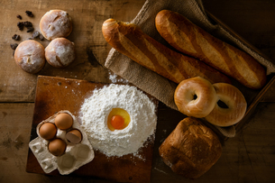 Fresh bread image. Breads,baguettes,bagels and flour with some eggs.の写真素材 [FYI04295369]