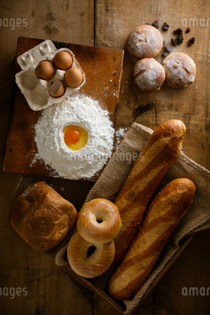 Fresh bread image. Breads,baguettes,bagels and flour with some eggs.の写真素材 [FYI04295374]