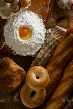 Fresh bread image. Breads,baguettes,bagels and flour with some eggs.の写真素材 [FYI04295377]