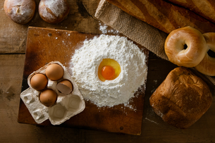 Fresh bread image. Breads,baguettes,bagels and flour with some eggs.の写真素材 [FYI04295380]
