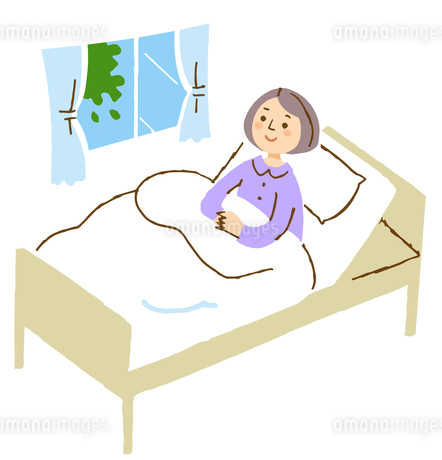 ベットに横になる女性のイラスト素材 [FYI04308268]