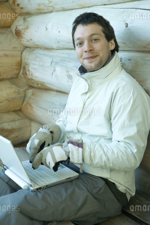 Man using laptop with gloves onの写真素材 [FYI04319009]