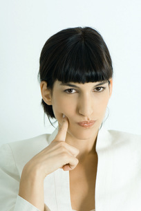 Woman, holding finger to cheekの写真素材 [FYI04319268]