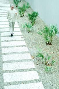 man walking on pathの写真素材 [FYI04319466]