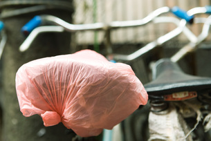 Bicycle, plastic bag covering seatの写真素材 [FYI04319659]