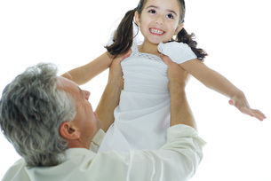 man lifting up girl into the airの写真素材 [FYI04321182]