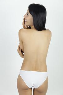 Woman standing in underwear, rear viewの写真素材 [FYI04322037]