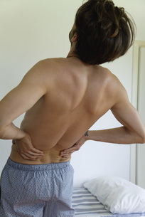 Man experiencing lower back painの写真素材 [FYI04322180]