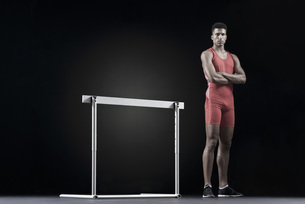 Male athlete standing by hurdleの写真素材 [FYI04322538]