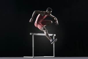 Male athlete cearling hurdleの写真素材 [FYI04322565]