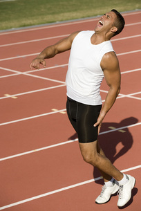 Runner on running track with painful expressionの写真素材 [FYI04322673]