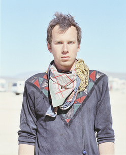Portrait of confident man standing in desert on sunny day, Black Rock Desert, Nevada, USAの写真素材 [FYI04322899]