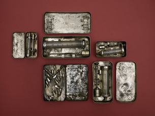 Directly above shot of old-fashioned medical tools on red backgroundの写真素材 [FYI04322900]