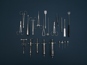 Directly above shot of various medical tools on blue backgroundの写真素材 [FYI04322903]