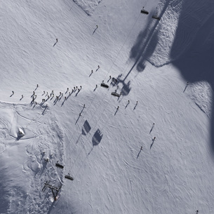 Aerial view of skiers on snow covered fieldの写真素材 [FYI04322915]