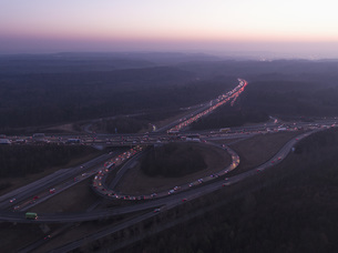 Aerial view of intersecting highways amidst landscape at sunset, Stuttgart, Germanyの写真素材 [FYI04322989]