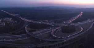 Aerial view of intersecting highways amidst landscape at sunset, Stuttgart, Germanyの写真素材 [FYI04322990]