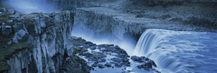 High angle view of waterfall from rocky cliff, Dettifoss, Icelandの写真素材 [FYI04323053]