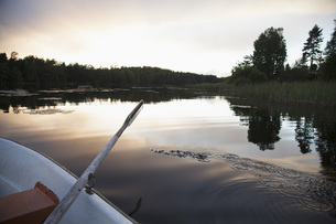 Cropped image of rowboat moored on lake during sunsetの写真素材 [FYI04323181]