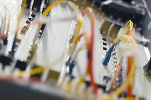 Close-up of power and network cables plugged into circuit boardの写真素材 [FYI04323205]
