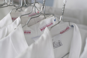 Close-up of white shirts hanging on railの写真素材 [FYI04323215]