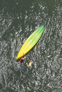Directly above shot of man with upside down kayak in waterの写真素材 [FYI04323300]