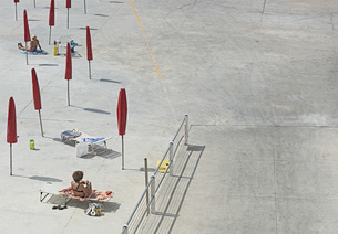 High angle view of women sunbathing at beach during sunny dayの写真素材 [FYI04323310]