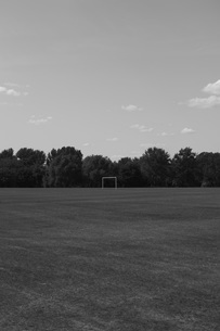 Distant view of goal post on soccer field against skyの写真素材 [FYI04323483]