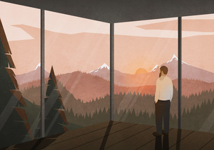 Man enjoying tranquil view of sunset behind mountains from glass houseのイラスト素材 [FYI04323698]