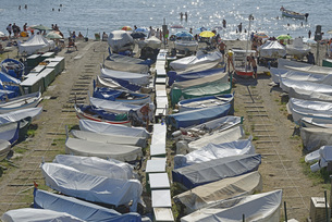 Boats covered at sunny waterfront, Genoa, Liguria, Italyの写真素材 [FYI04324218]
