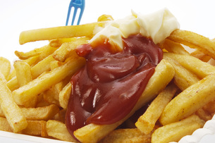 French fries with mayonnaise and ketchupの写真素材 [FYI04332864]