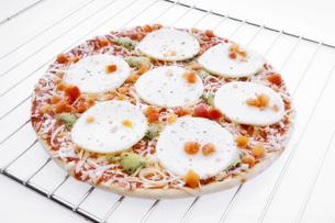 frozen pizza with mozzarella in ovenの写真素材 [FYI04332889]