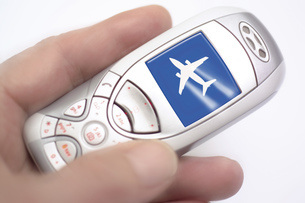 Mobile phone with airplane on display, symbol for mobile fliの写真素材 [FYI04332979]