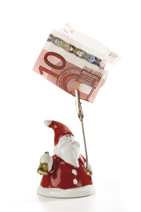 Santa Claus Figurine holding Euro noteの写真素材 [FYI04332995]