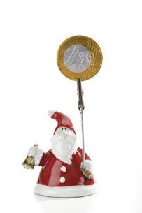 Santa Claus Figurine holding Euro coinの写真素材 [FYI04332997]