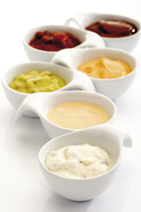 Dips in bowls, close-upの写真素材 [FYI04333132]