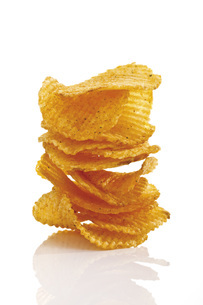 Stack of Potato chili chips, close-upの写真素材 [FYI04333277]