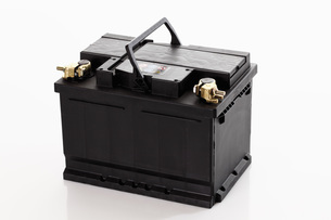 Car battery against white backgroundの写真素材 [FYI04333491]