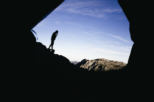 Spain, Picos de Europa, silhouette of a man with mountains lの写真素材 [FYI04333741]
