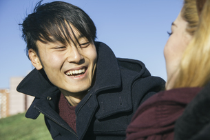 Portrait of laughing young man face to face with his girlfriの写真素材 [FYI04333760]
