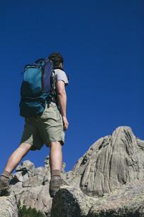 Spain, hiker with a backpack in Regional Park La Pedrizaの写真素材 [FYI04333793]