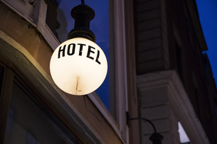 Lighted lamp with the word 'hotel' in front of facade by nigの写真素材 [FYI04333989]