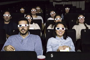 People with 3d glasses watching a movie in a cinemaの写真素材 [FYI04333991]